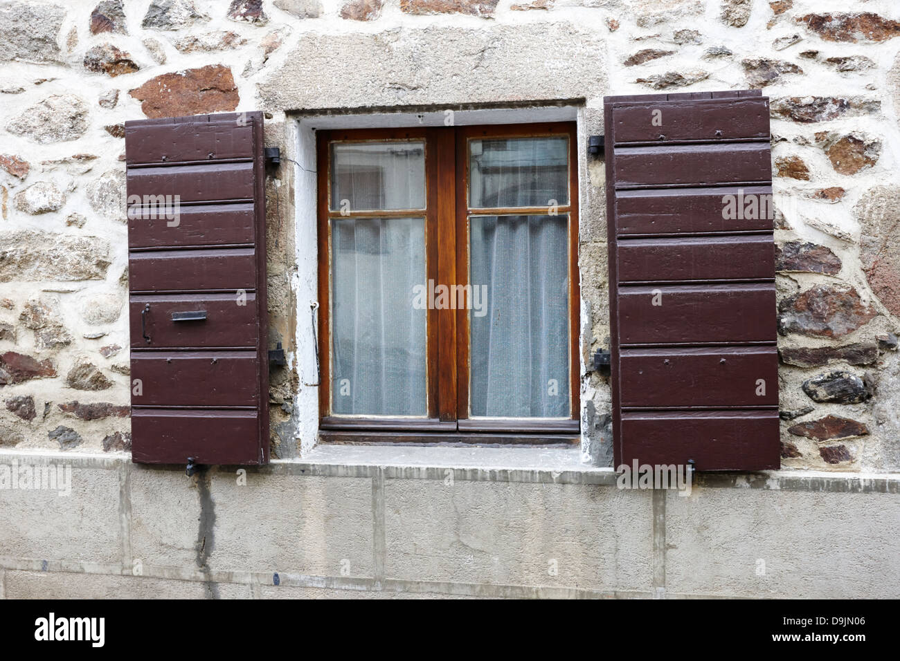 house window shutters decorative wooden window shutters on old historic stone house montlouis pyreneesorientales france stock