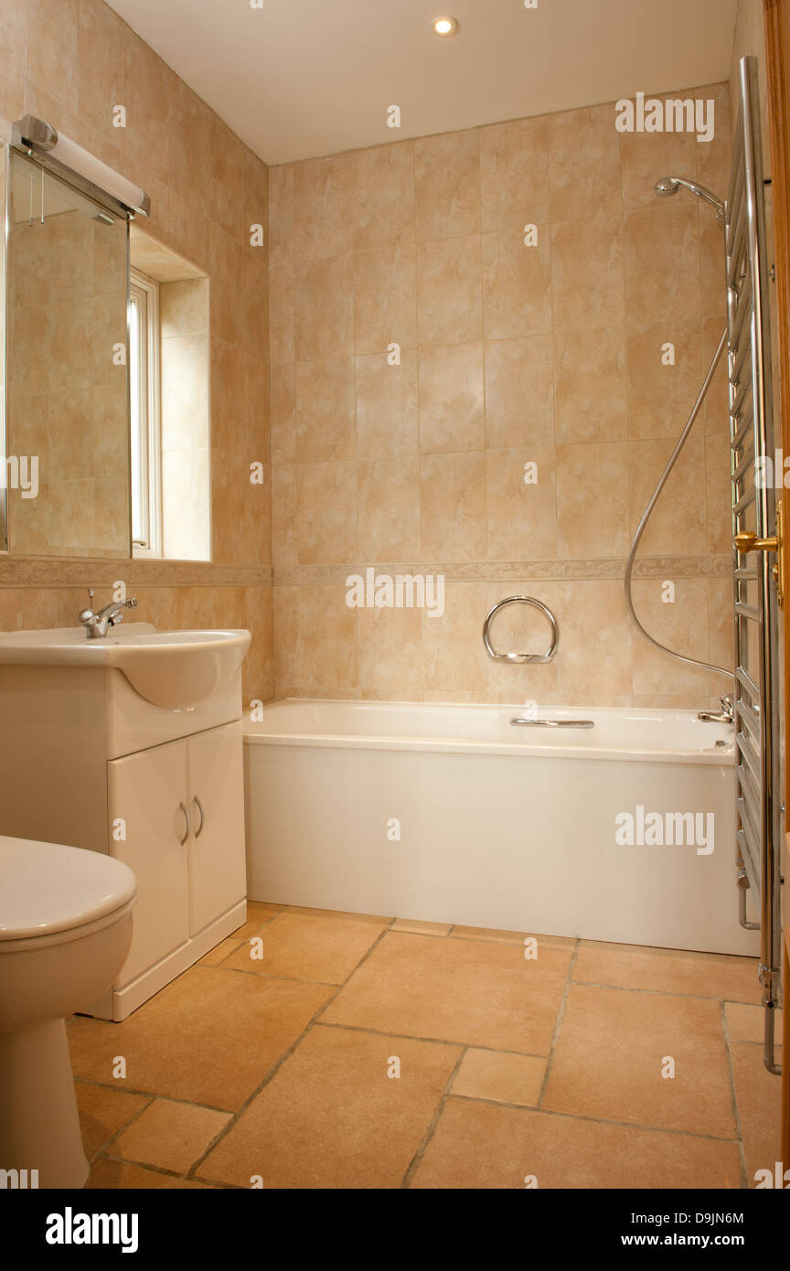 Contemporary White Suite In A Fully Tiled Bathroom Stock Photo - Fully tiled bathroom