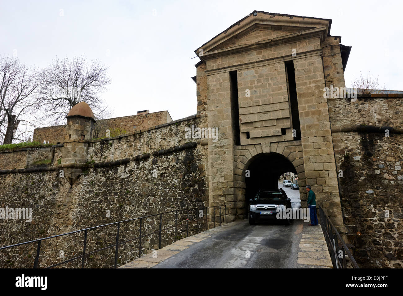 car driving through internal gateway to mont-louis fortress of vauban unesco world heritage site city walls pyrenees - Stock Image