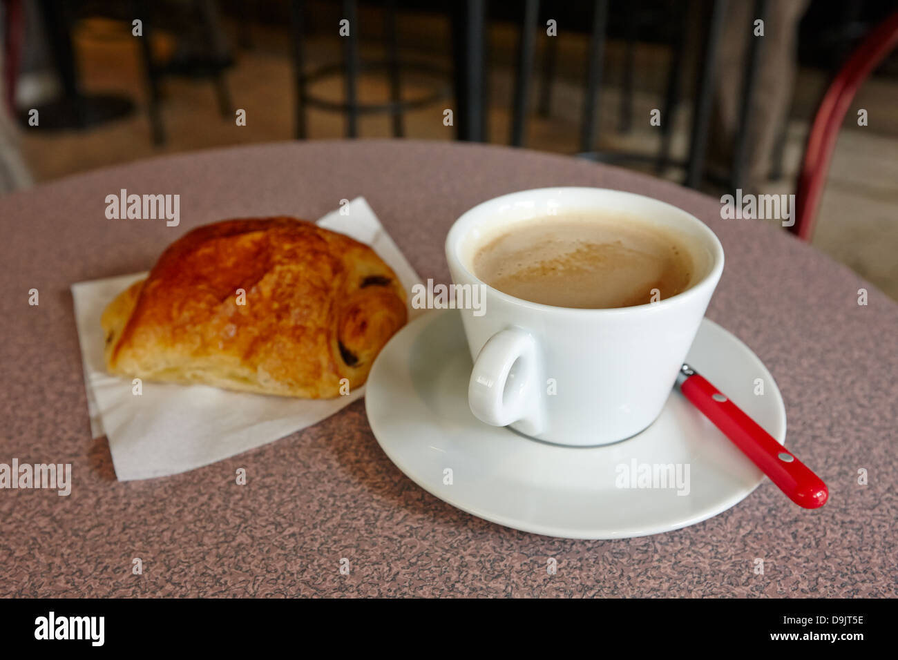 cafe au lait and pain au chocolate in a cafe bar in france Stock Photo