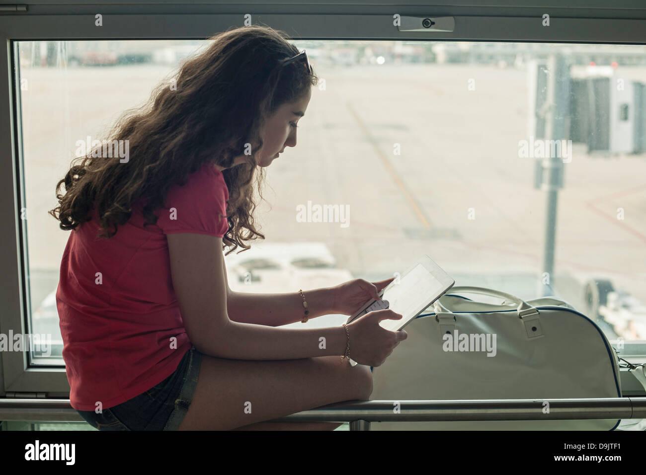 Teenage girl using digital tablet - Stock Image