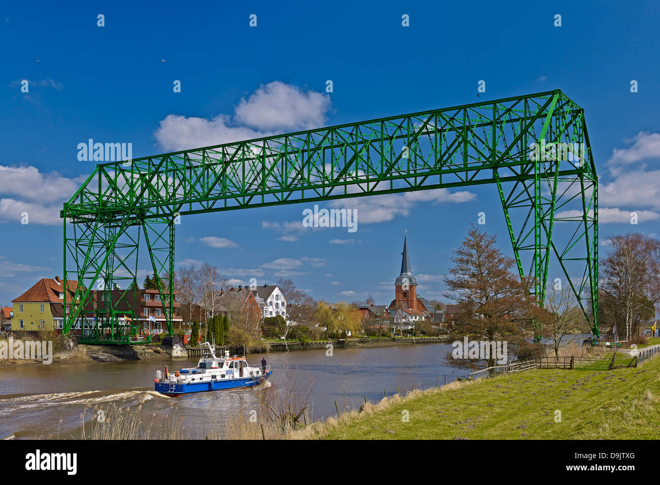 Transporter Bridge Hemmoor-Osten with St. Peters Church, Lower Saxony, Germany - Stock Image