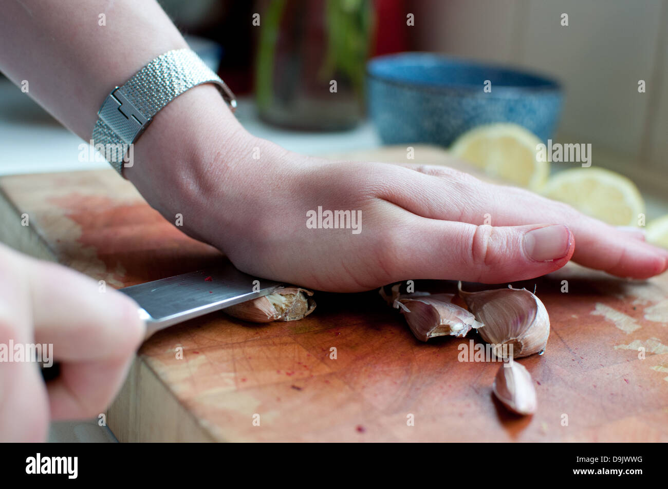 squashing garlic - Stock Image