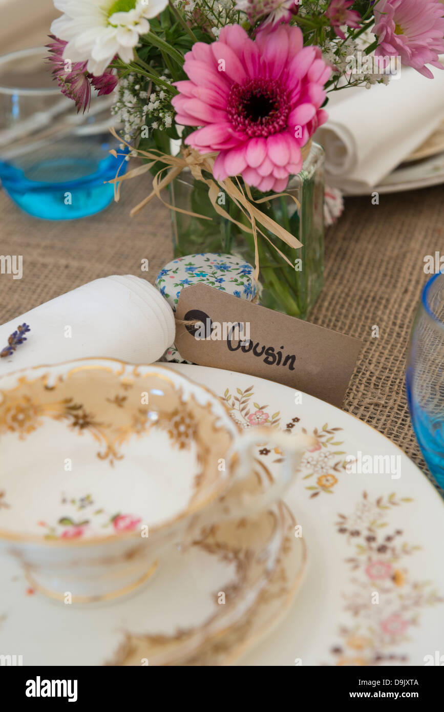 A table set for a meal using a vintage theme. - Stock Image