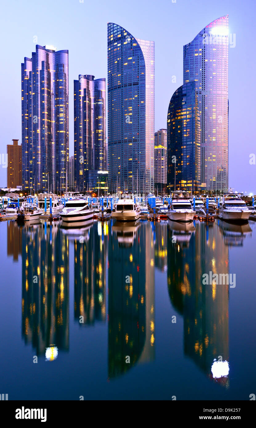 Skyline of luxury residential high rises in the Haeundae district of Busan, South Korea at dusk. - Stock Image