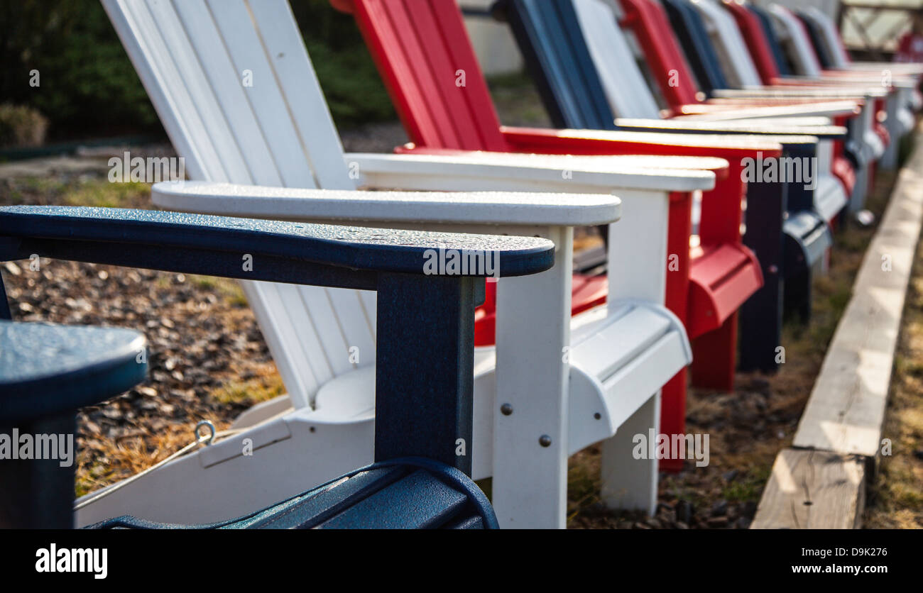 Amazing Adirondack Chairs In Red White And Blue Set Up For The Short Links Chair Design For Home Short Linksinfo