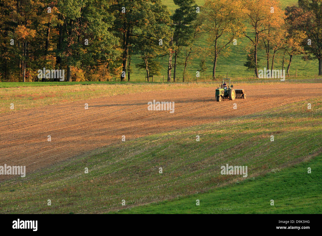 farm farmer field rural country tractor plow soil dirt agriculture - Stock Image