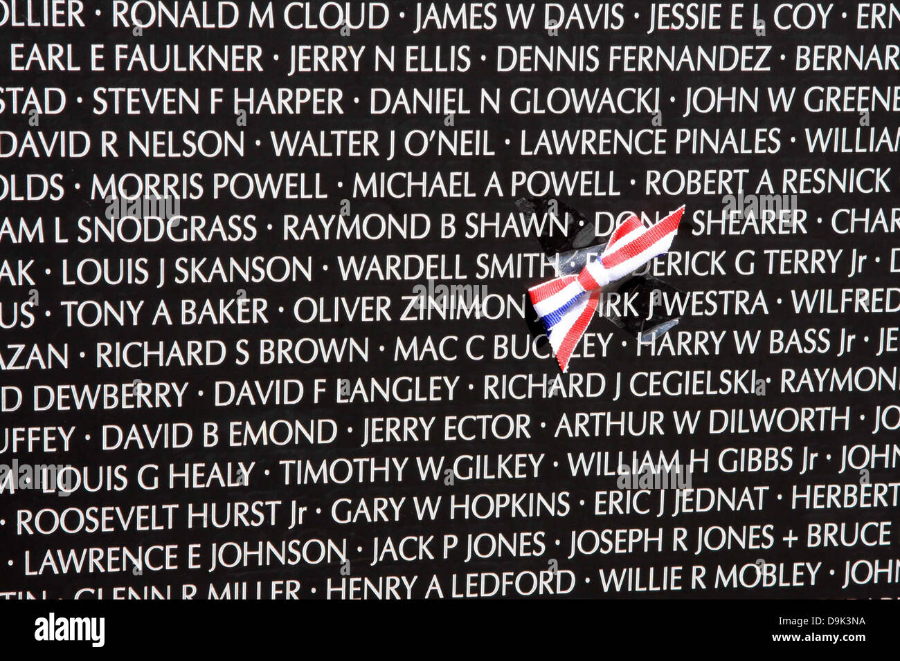 Closeup Of Names On The Traveling Vietnam War Memorial Wall With Red Stock Photo Alamy