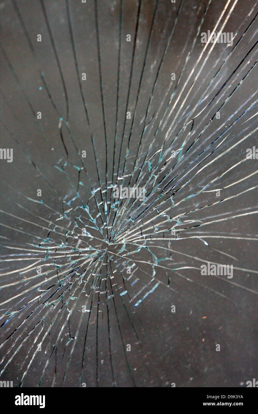 cracked crack broke broken window glass - Stock Image