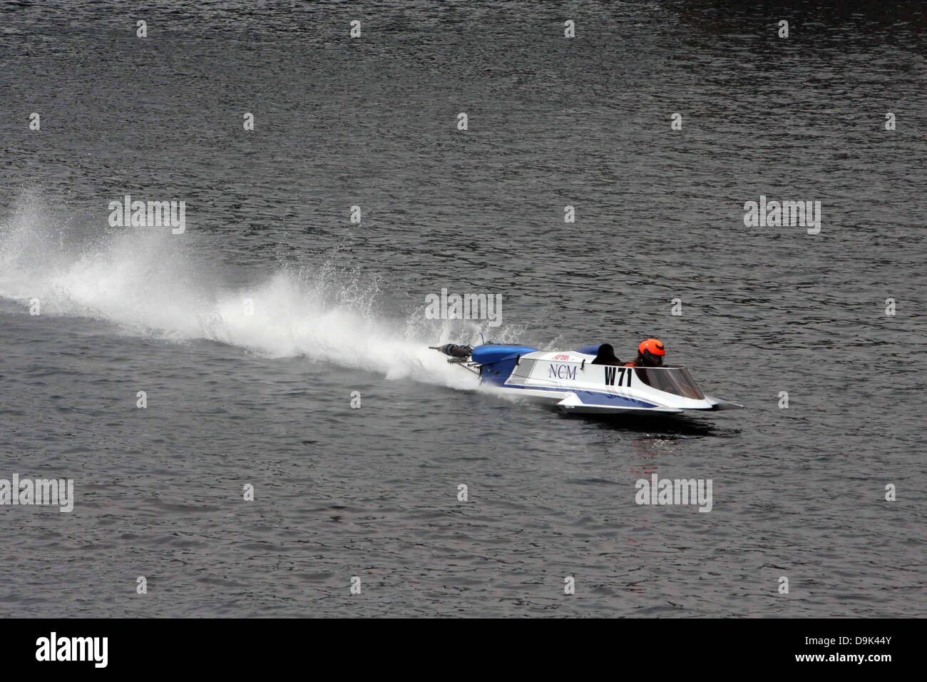 outboard boat races on water river Stock Photo