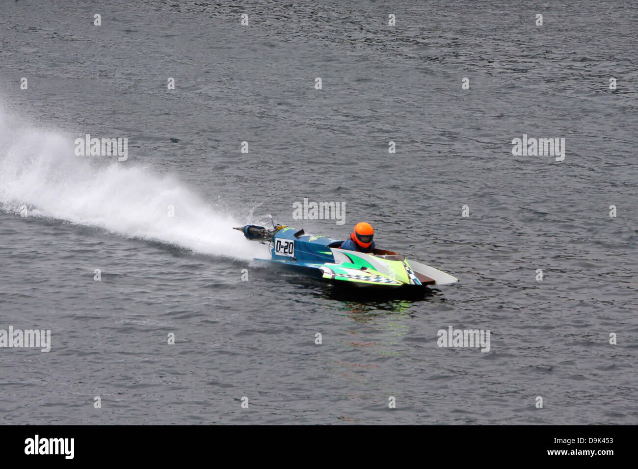 outboard boat races on water river - Stock Image