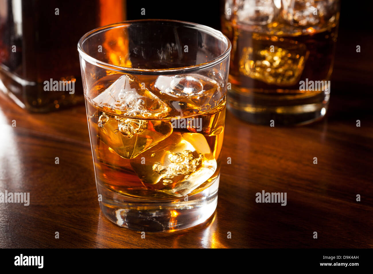 Golden Brown Whisky on the rocks in a glass - Stock Image
