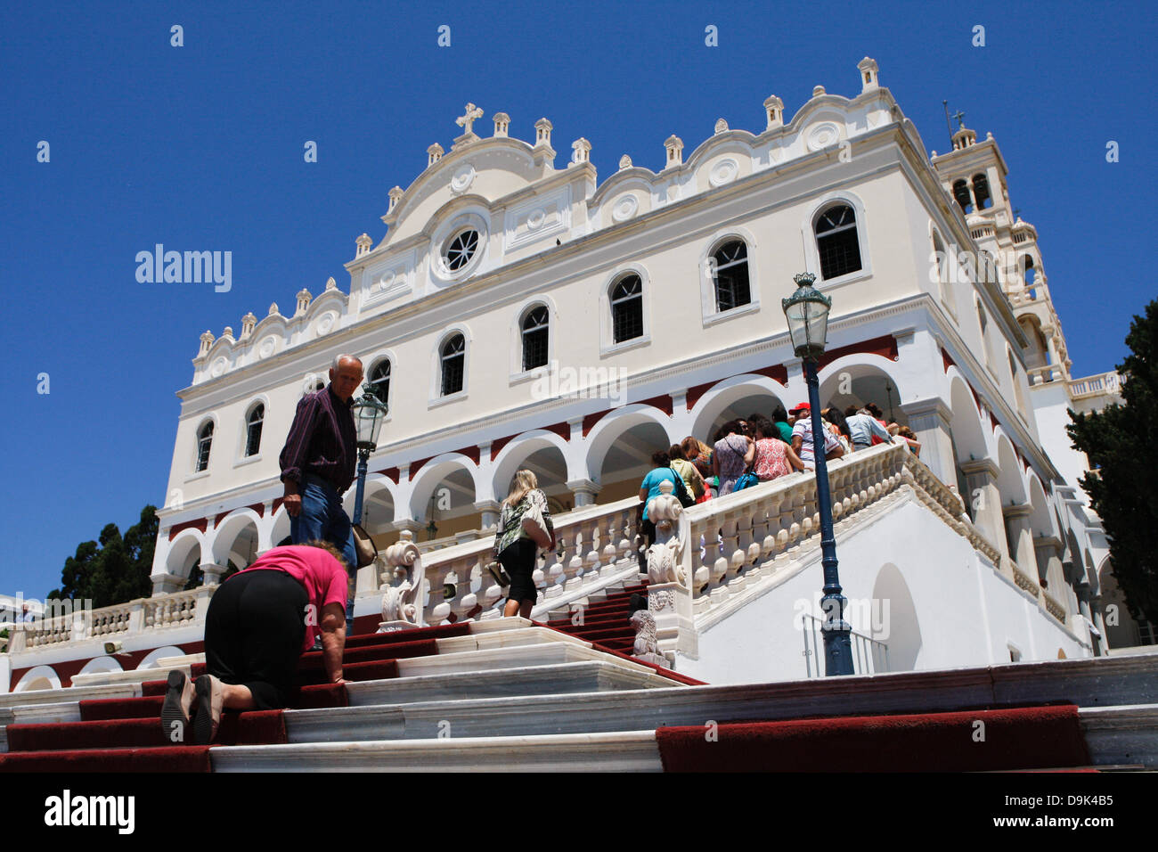 A Pilgrim crawl on her hands and knees to the shrine in the hope of miracles and blessings. Tinos, Greece. - Stock Image