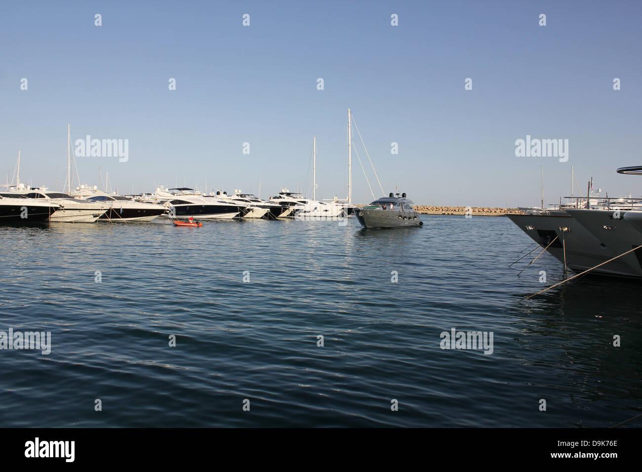 Luxury motor superyacht returning to berth in Puerto Portals marina, Calvia, South West Mallorca / Majorca, Balearic - Stock Image