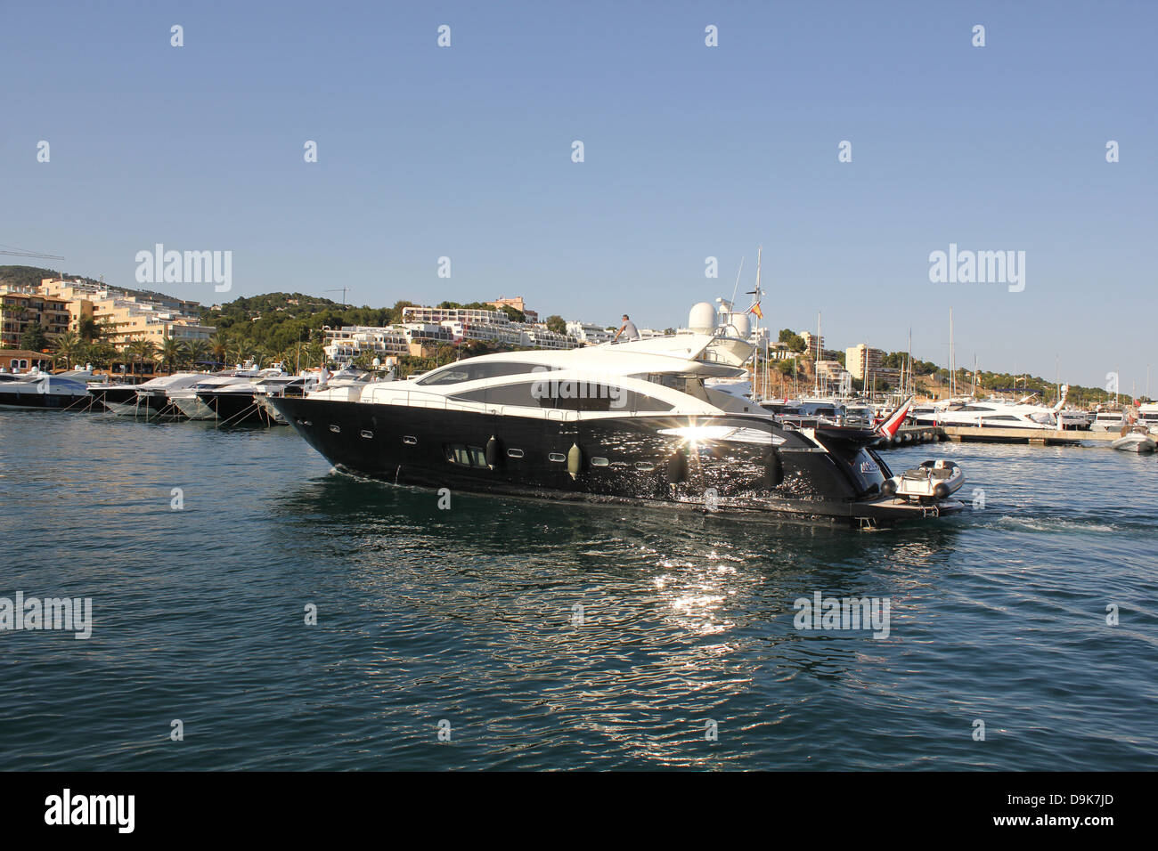 Luxury motor superyacht returning to berth - in Puerto Portals marina, Calvia, South West Mallorca / Majorca, Balearic - Stock Image