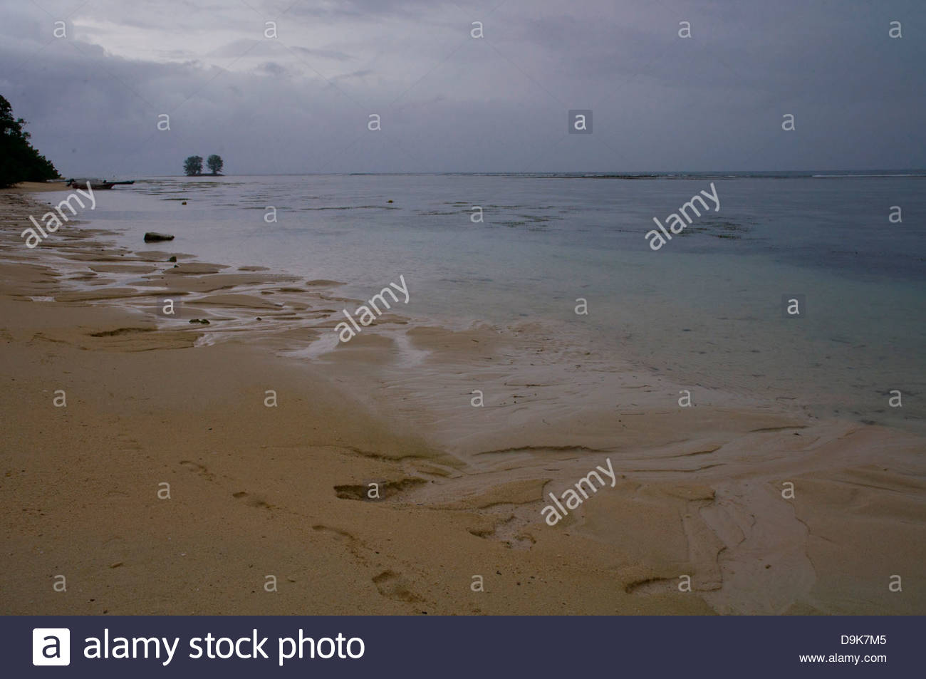 Low Tide on the beach during the storm, La Digue Island, Seychelles - Stock Image