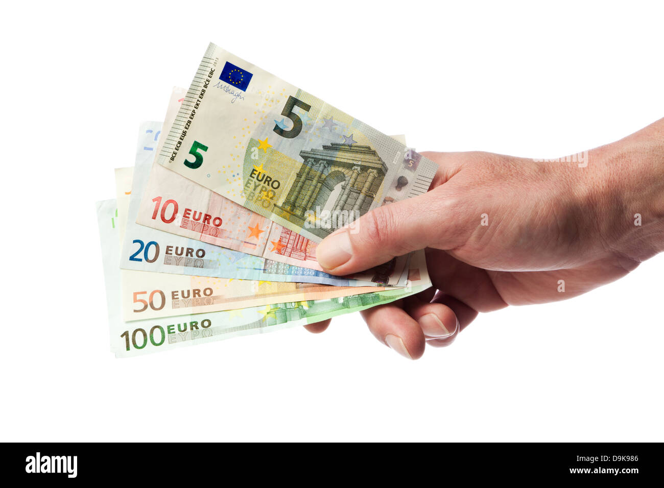 Male hand holding european currency bills from five to hundred euros fanned out, isolated on white background - Stock Image