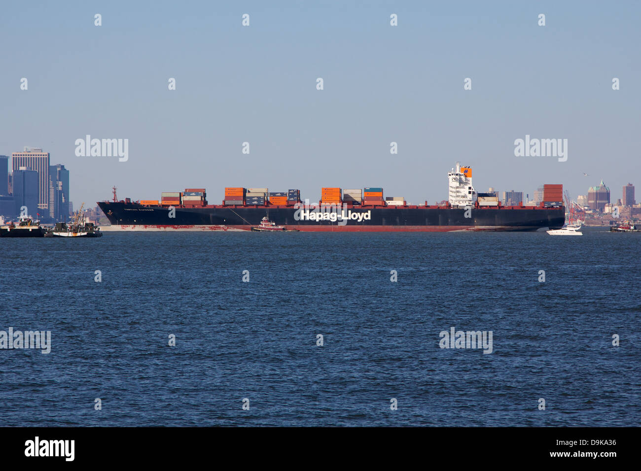 Container freighter Yantian Express passing through New York Harbor. - Stock Image