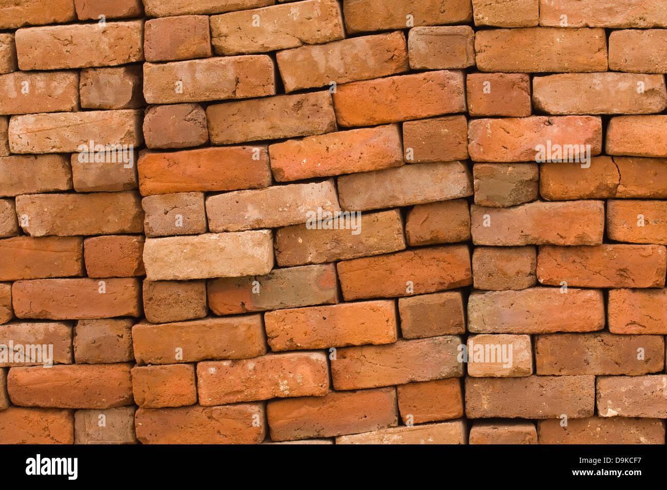 Asia, India, Tamil Nadu, Kanchipuram, piled red bricks - Stock Image