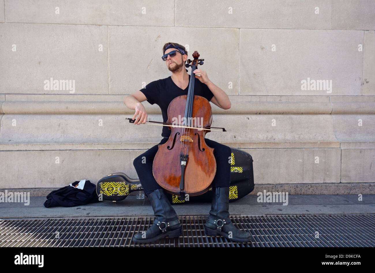 Portrait of a street musician playing the cello in Washington Square Park in Greenwich Village, New York City - Stock Image
