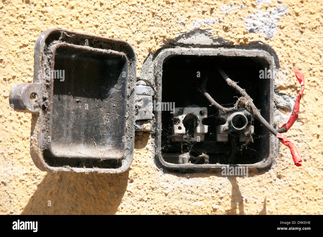 Electrical wires exposed on an open fuse box set into a wall, Budapest  Hungary -