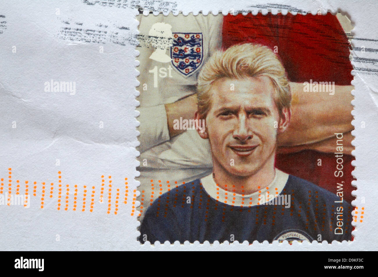 1st class stamp showing Stamp Denis Law, Scotland stuck on white envelope - Stock Image