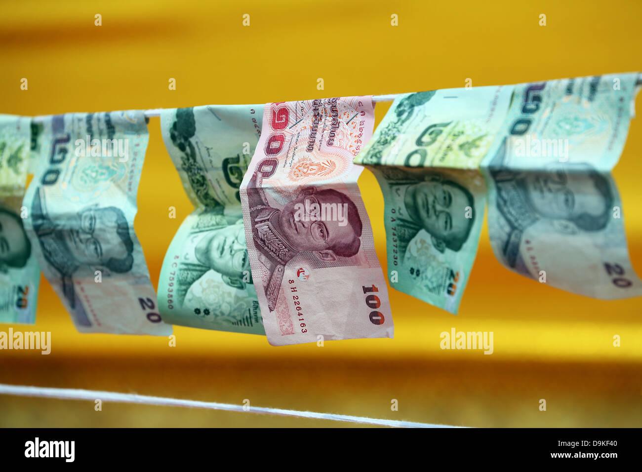 Donations of Thai money at the Golden Mount, Wat Saket Temple, Bangkok, Thailand - Stock Image