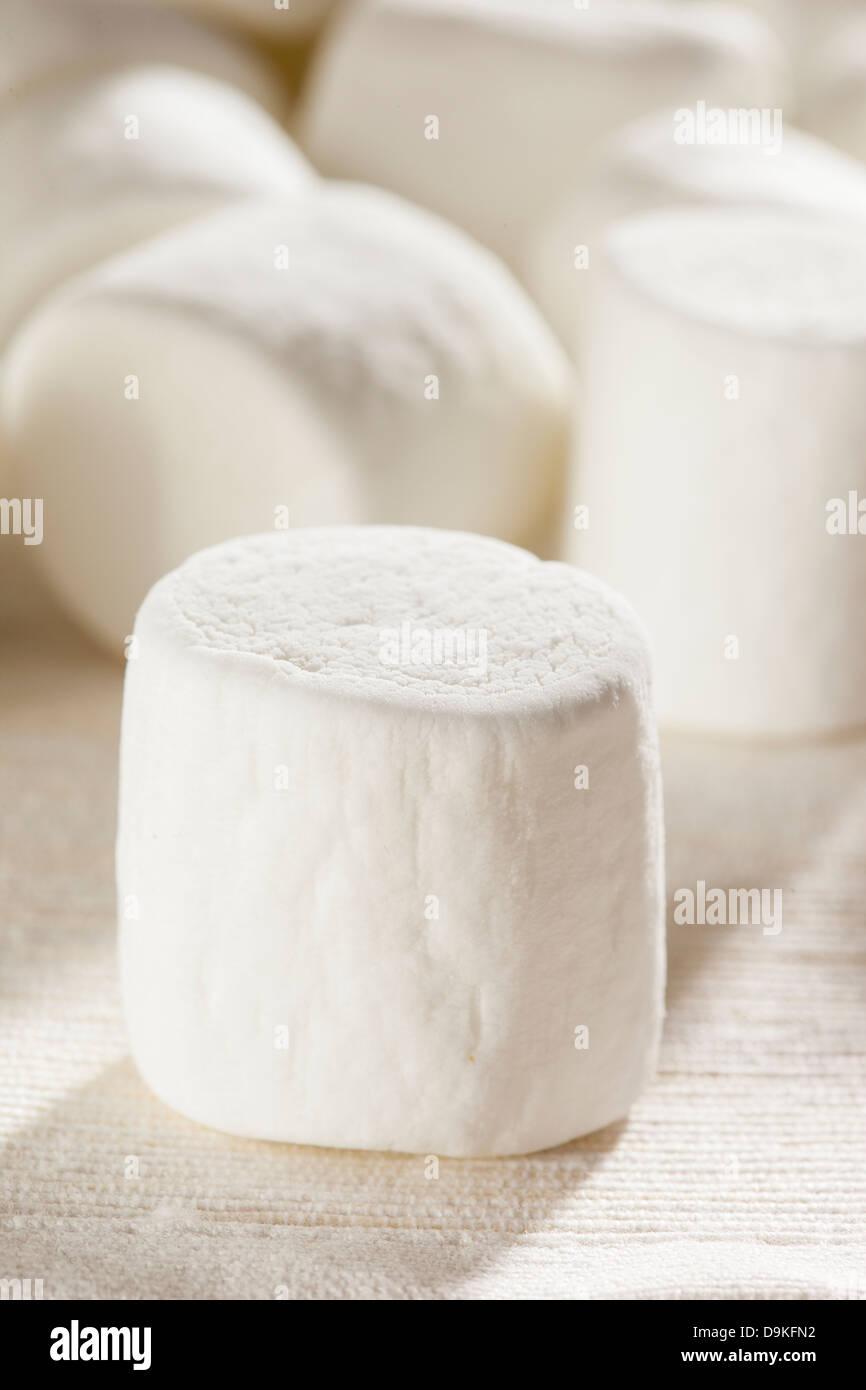 Delicious White Fluffy Round Marshmallows ready to eat - Stock Image
