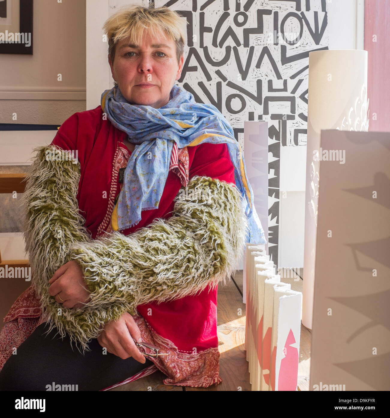 Welsh visual artist RUTH JEN EVANS, with some of her work at Oriel y Bont, Aberystwyth Wales UK - Stock Image