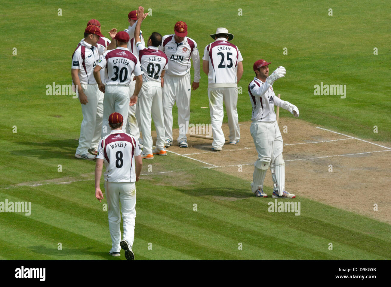 Manchester, UK. 21 June 2013 Lancs v Northants Emirates Old Trafford, Manchester, UK The Northants players congratulate - Stock Image