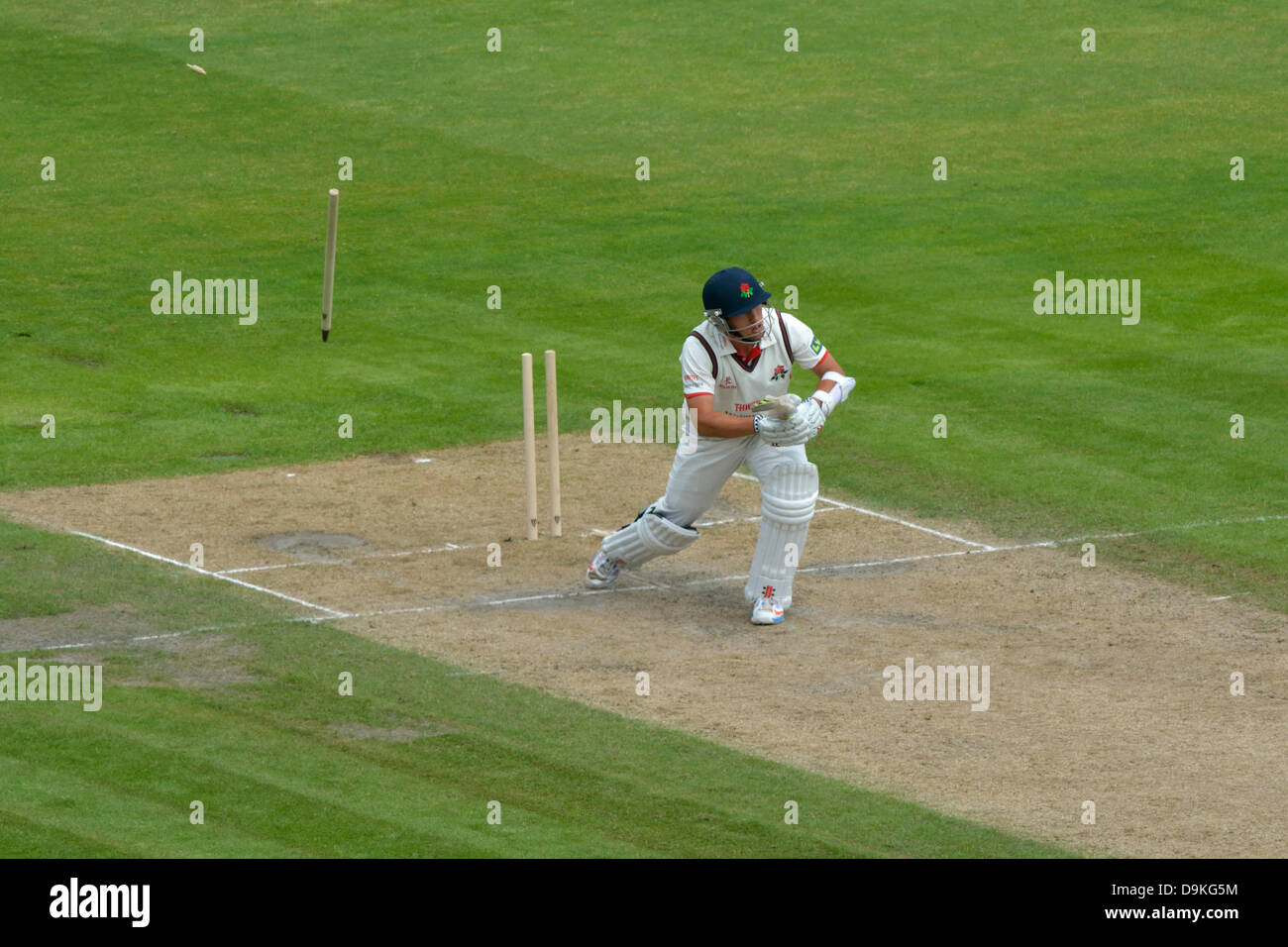 Manchester, UK. 21 June 2013 Emirates Old Trafford, Manchester, UK  Simon Kerrigan (Lancs) is bowled out by Azharullah - Stock Image