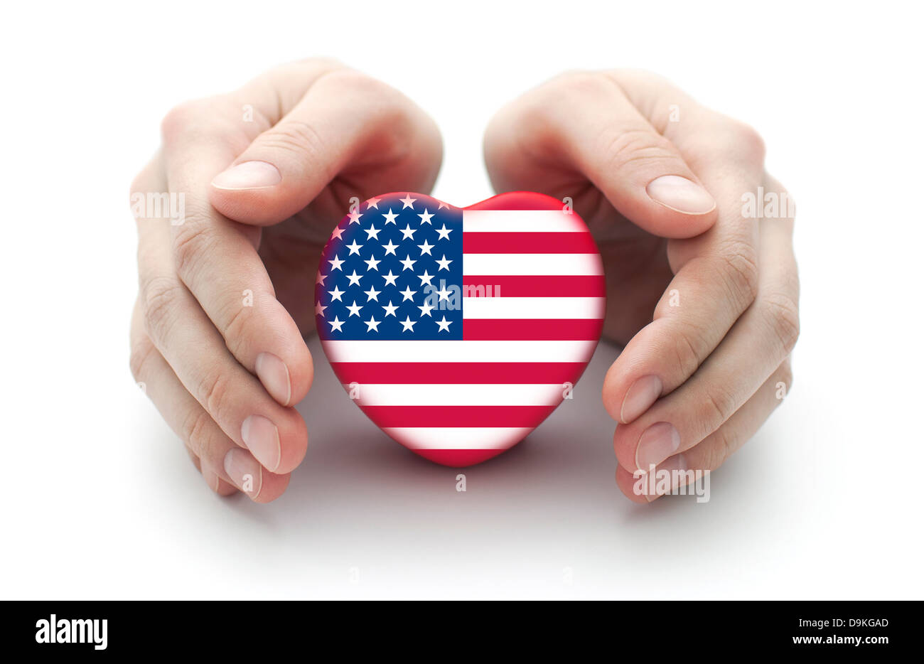Hands covering U.S. heart on white background - Stock Image
