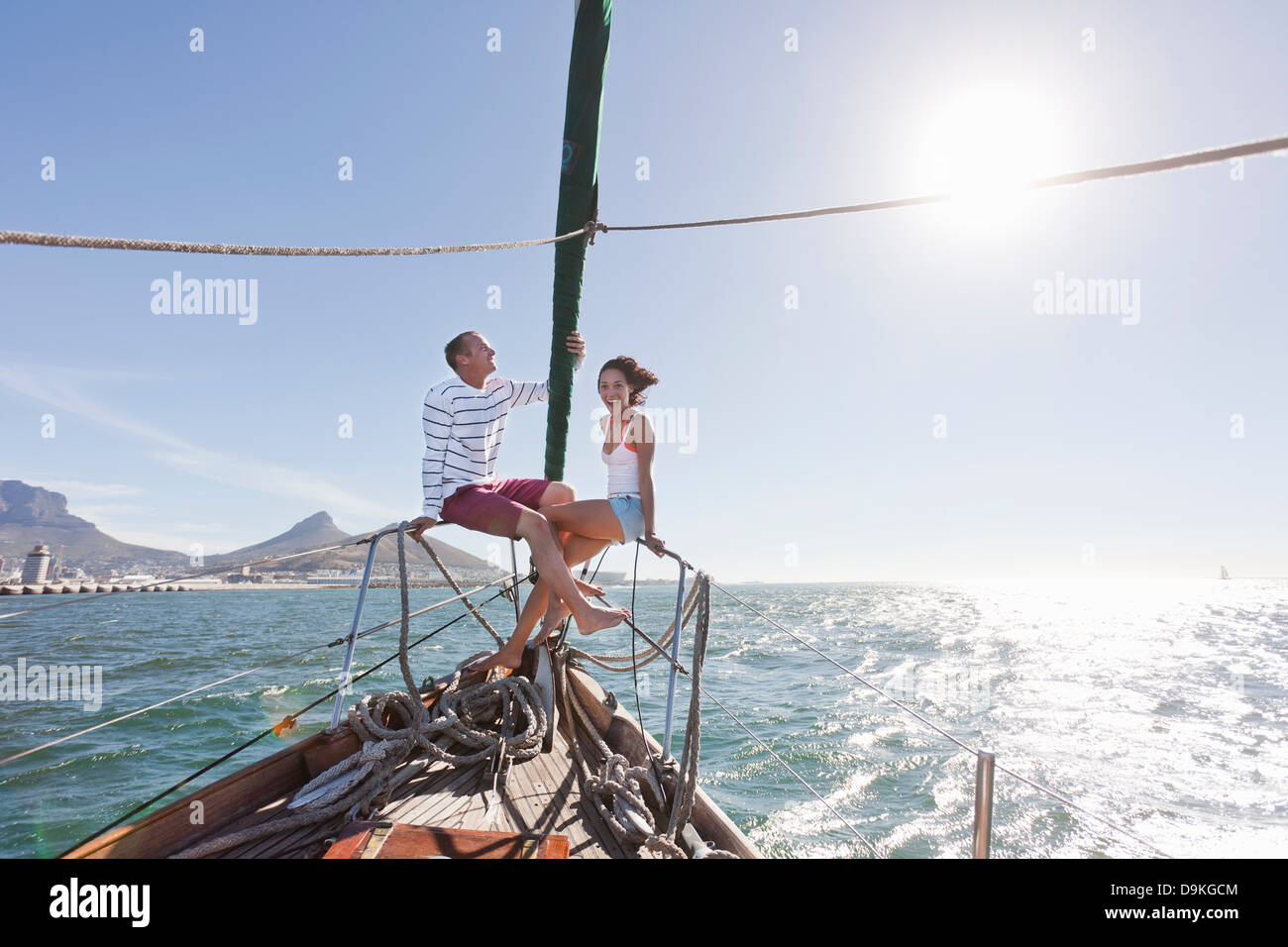 Young couple on deck of yacht - Stock Image