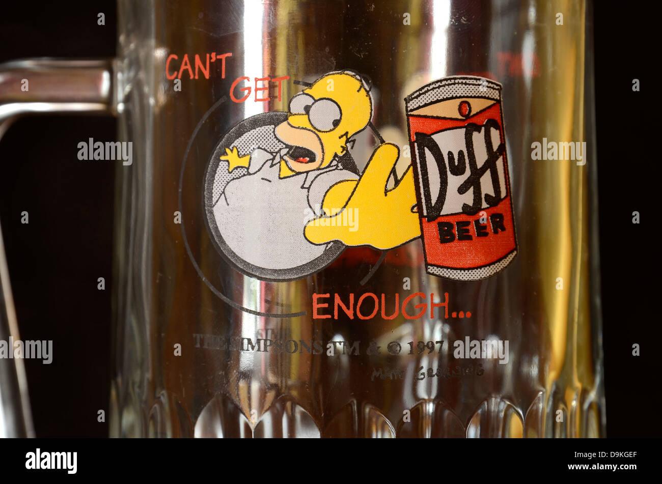 A Homer Simpson 'duff beer' beer glass - Stock Image