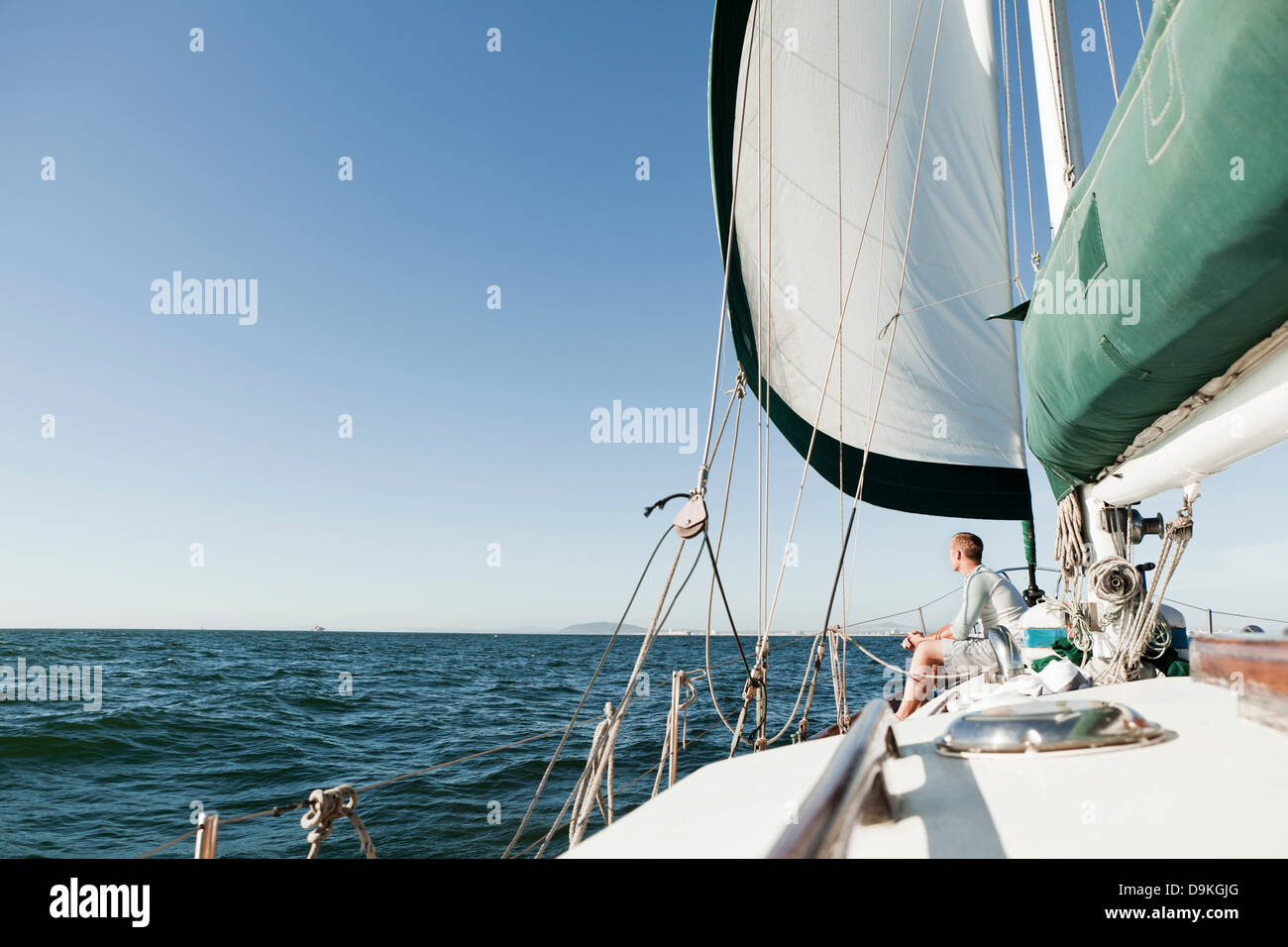 Young man on deck of yacht - Stock Image