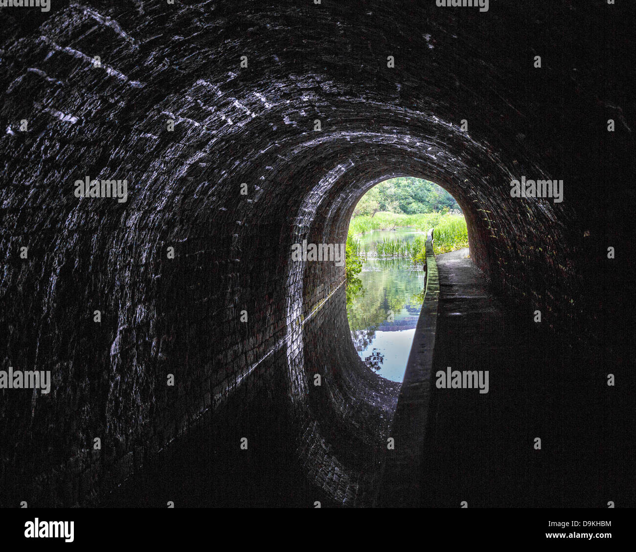 Inside the short Gregory Tunnel on the Cromford Canal near Matlock in Derbyshire UK - Stock Image