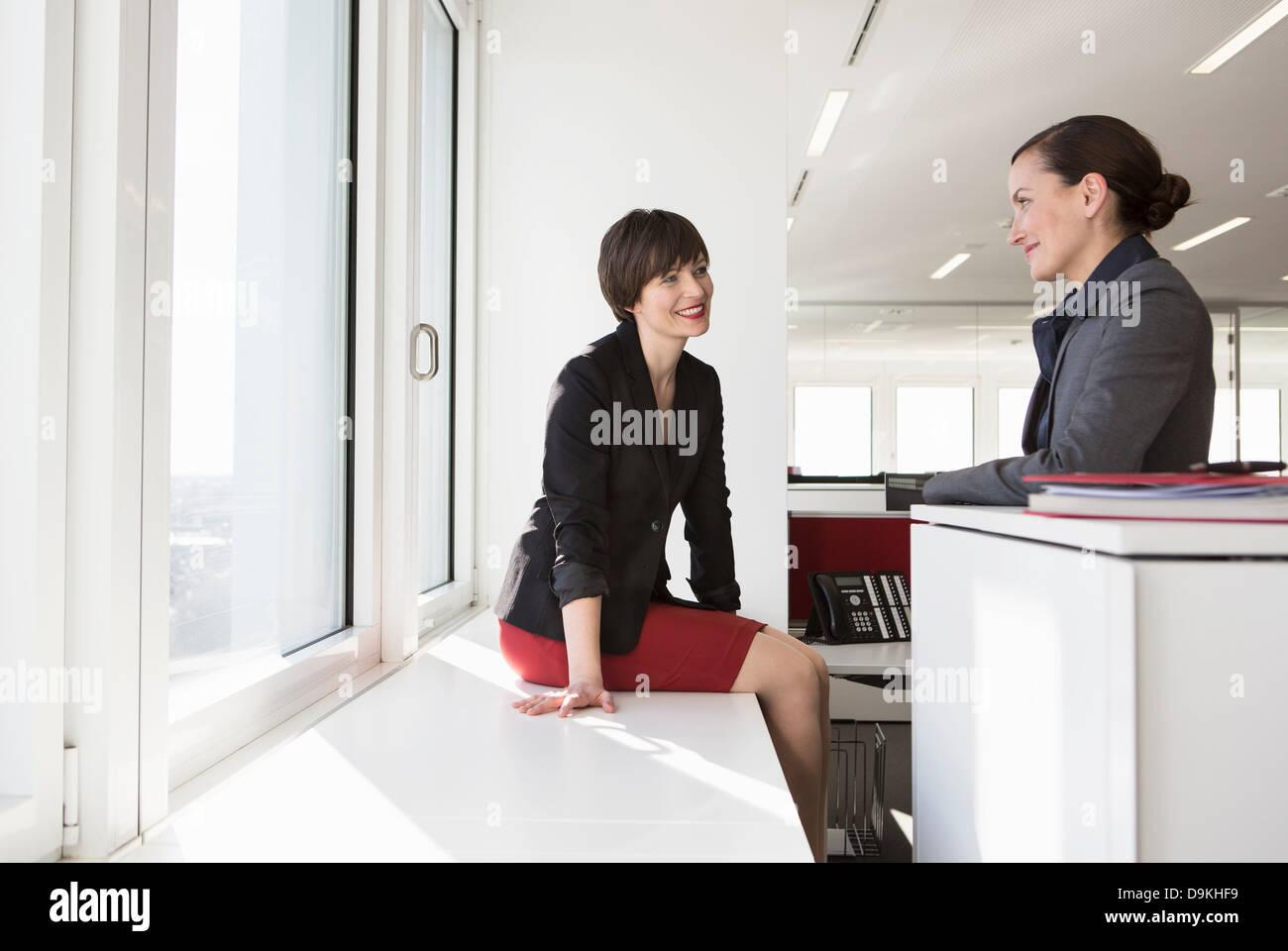 Two businesswomen having conversation - Stock Image
