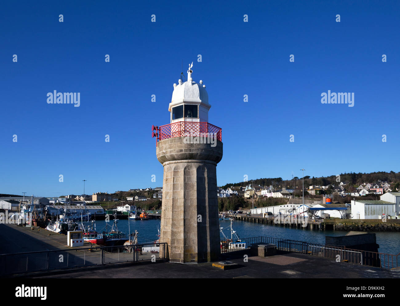 The lighthouse and fishing harbour, Dunmore East Fishing Port, County Waterford, Ireland - Stock Image