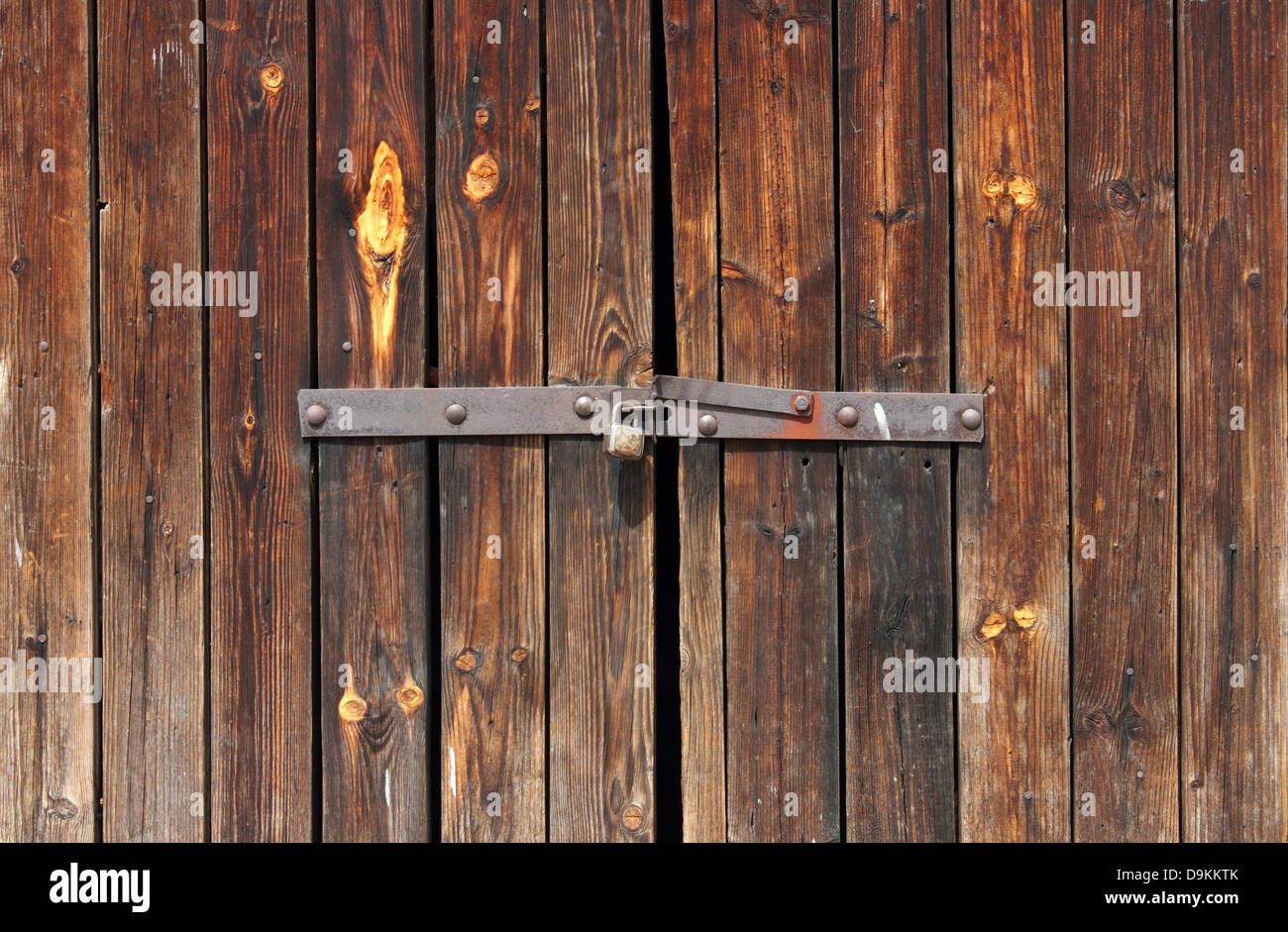 Old Wooden door locked with rusty padlock background. & Old Wooden door locked with rusty padlock background Stock Photo ...