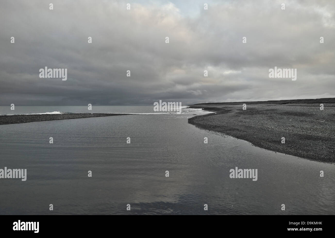 Grey lake in empty landscape - Stock Image