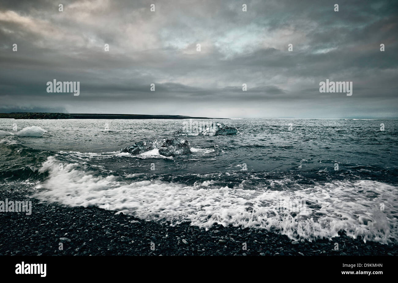 Icy sea on rocky shore - Stock Image
