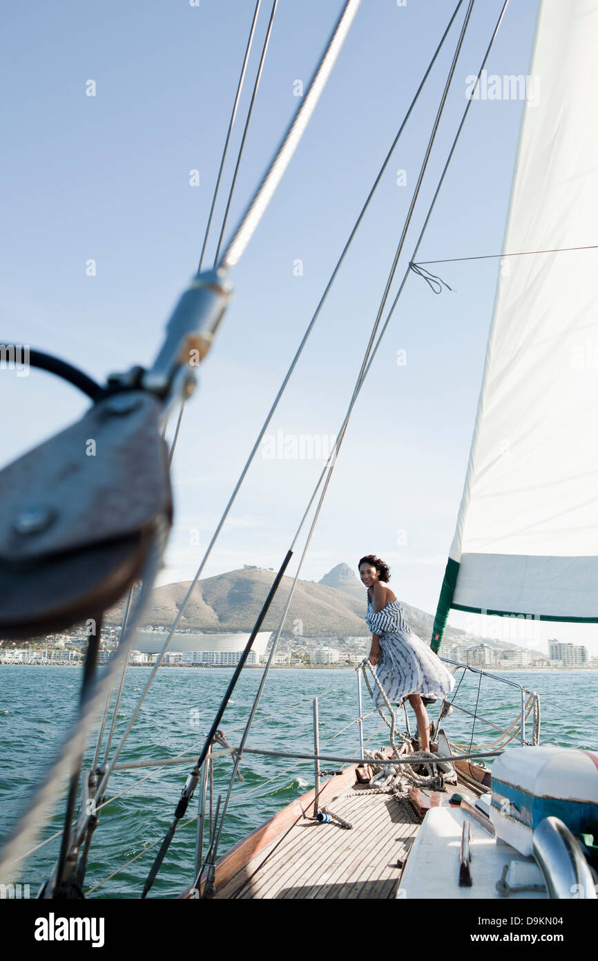 Young woman on deck of yacht - Stock Image