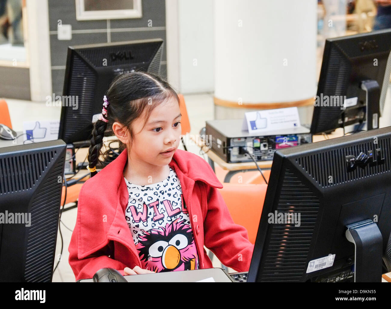 Basildon, Essex, UK.  21st June 2013.  A young girl engrossed in playing a computer game at the South Essex College - Stock Image
