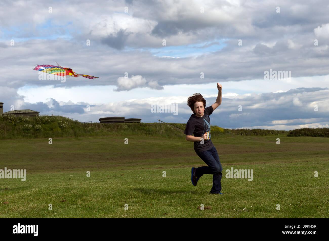 Boy flying kite - Stock Image