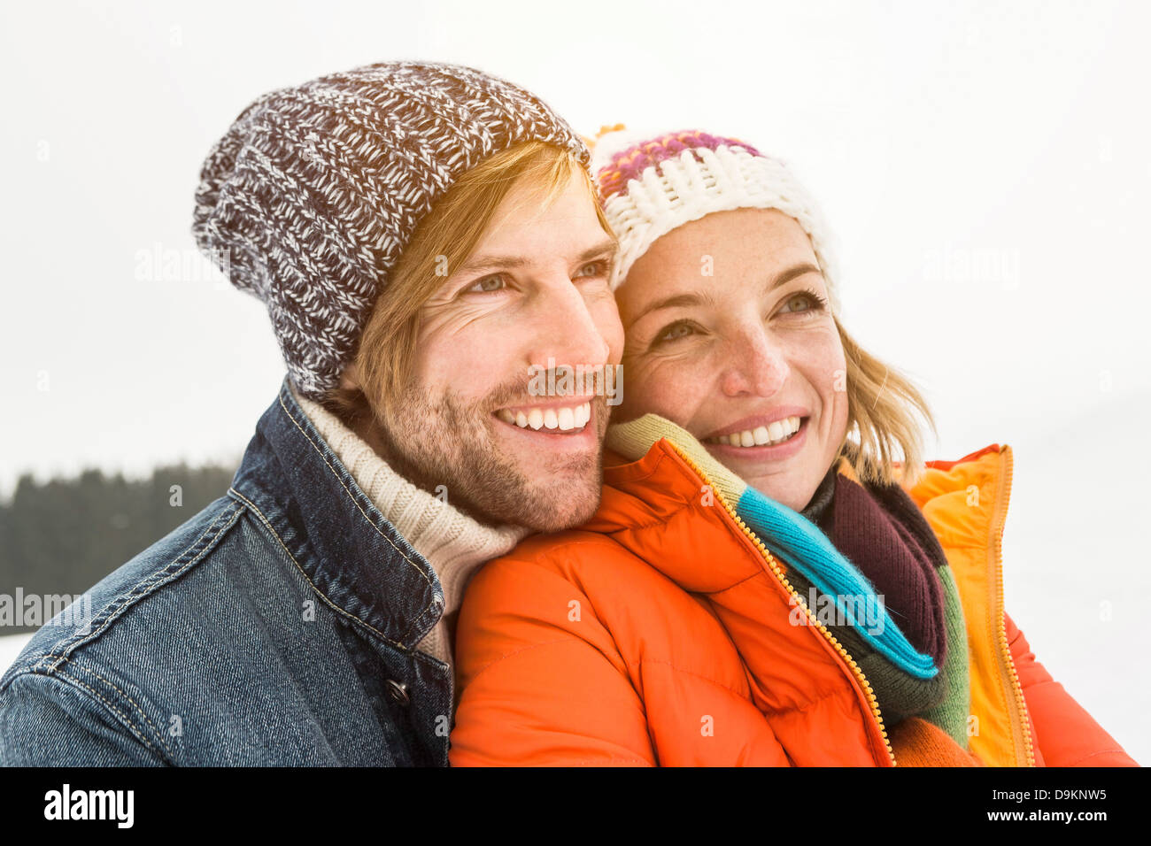 Portrait of couple wearing knit hats - Stock Image