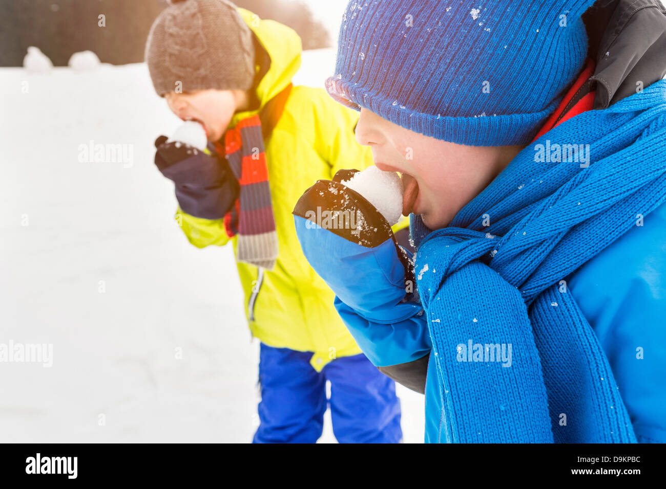 Two boys licking snowballs - Stock Image