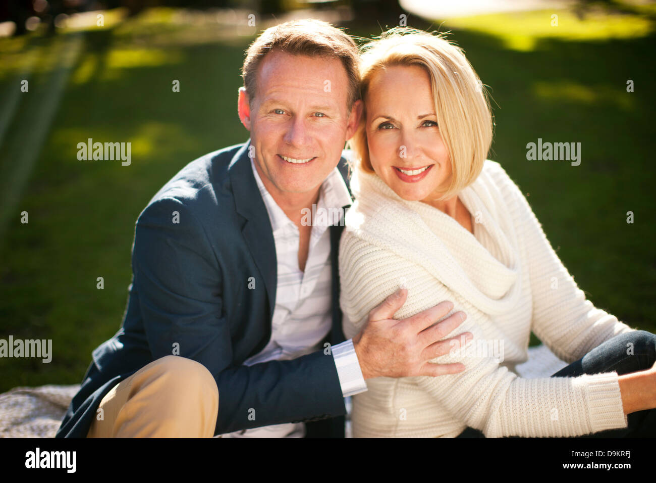 Loving heterosexual couple in park - Stock Image