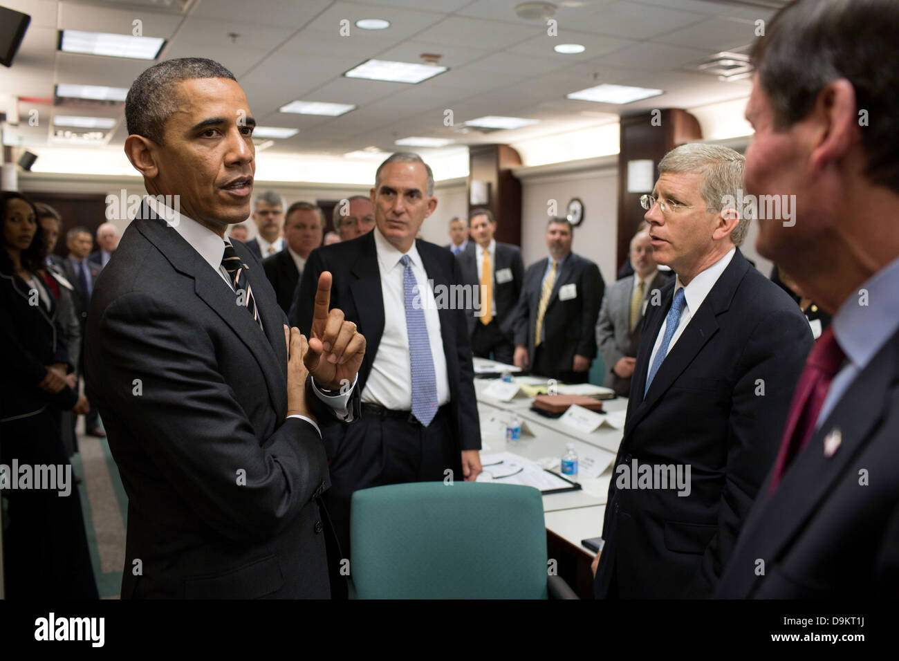 US President Barack Obama talks with electric utility executives and trade association representatives before a - Stock Image