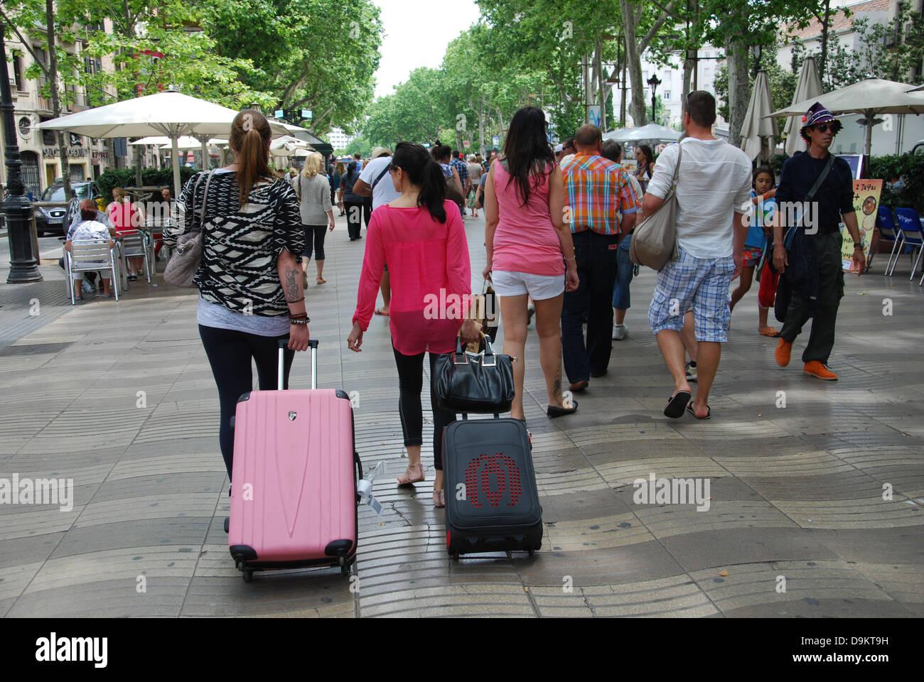 tourists on Ramblas shopping street Barcelona Spain - Stock Image