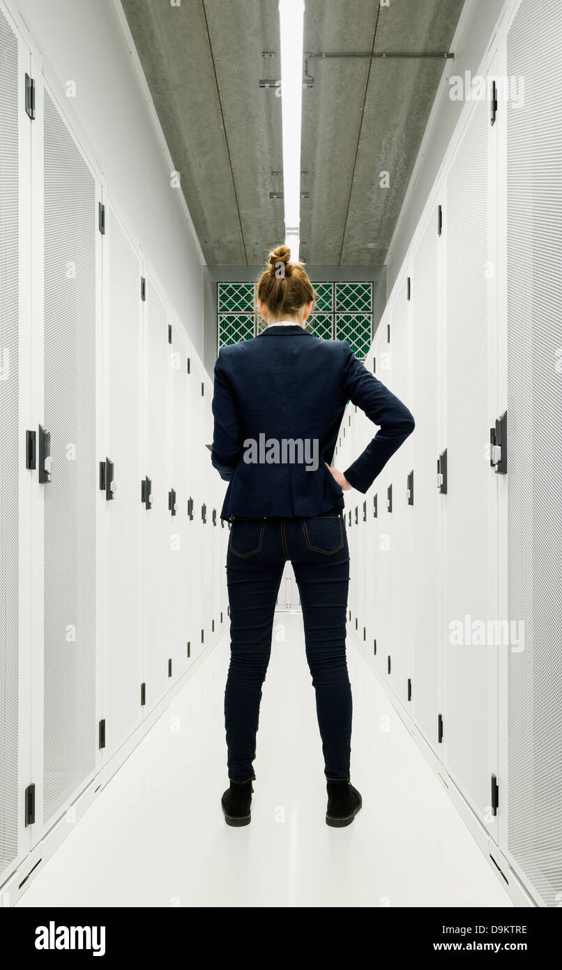 One employee standing in data storage room - Stock Image